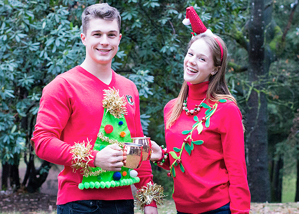 Christmastime Proposal while Christmas Caroling with Hot Cocoa