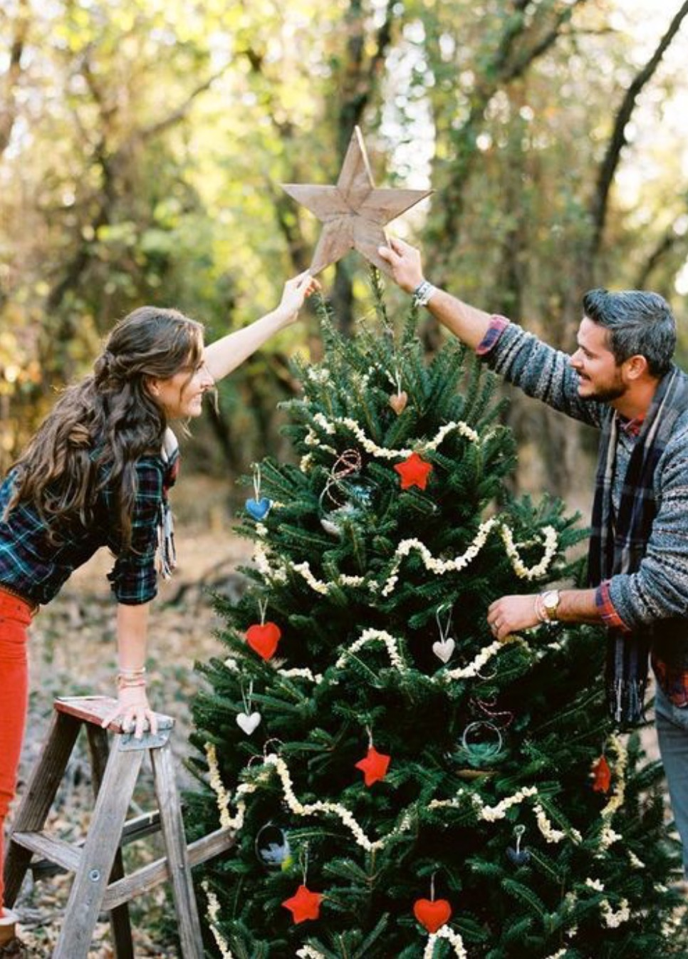 Christmastime Proposal while Christmas Tree Trimming