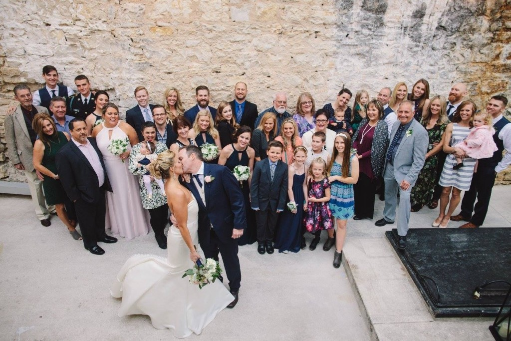 Tirzah Real Wedding Jake and Whitney Rustic Rock Wall Backdrop Group Photo