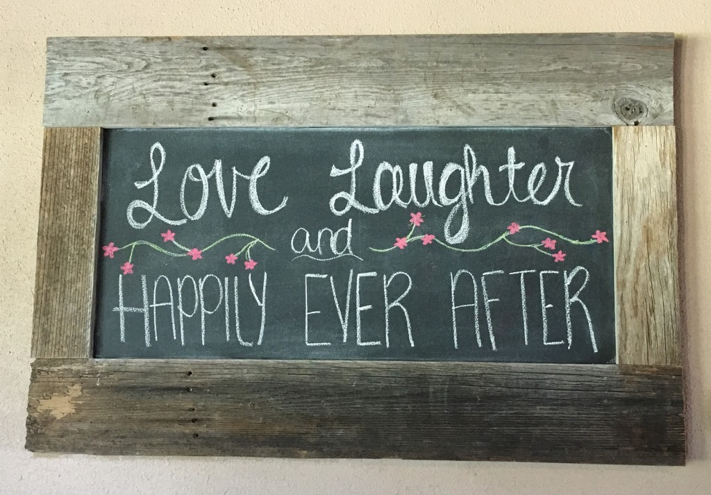 Tirzah Central Texas Wedding Josh and Ashley Champ Rustic Acres Chalkboard Wall behind Bar