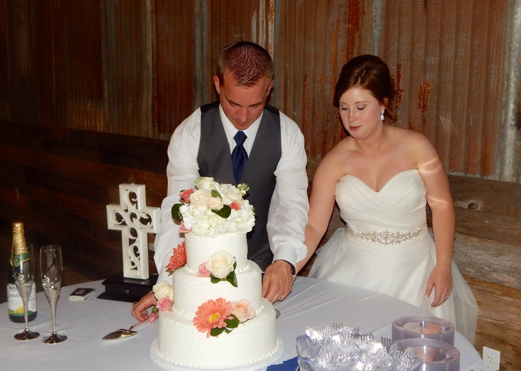 Tirzah Central Texas Wedding Josh and Ashley Champ Rustic Acres Reception Cake Cutting